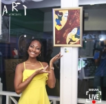 Multi-Medium Artist, Gabrielle (Williams) Burgess of GW Art poses with one of her new pieces, 'Two of a Kind' at The Reggae Mill Bar's Art Wednesdays at Devon House last September 19 (Photo: Skkan Media)